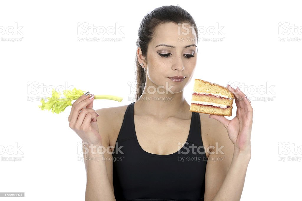Woman Holding Cake and Celery royalty-free stock photo