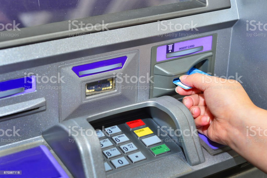 Woman holding card ,using ATM stock photo