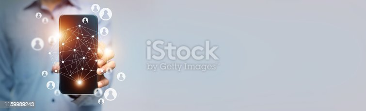 497982910 istock photo Woman holding cellphone with virtual connection diagram 1159989243