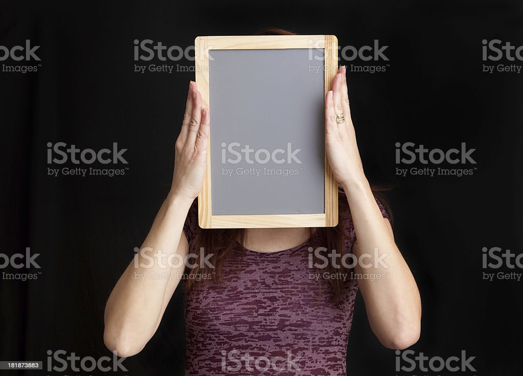 Woman Holding Chalkboard Over Her Face royalty-free stock photo