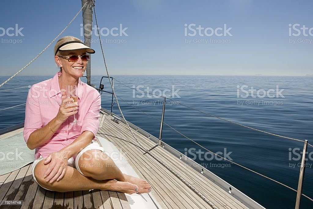 Woman holding champagne flute stock photo
