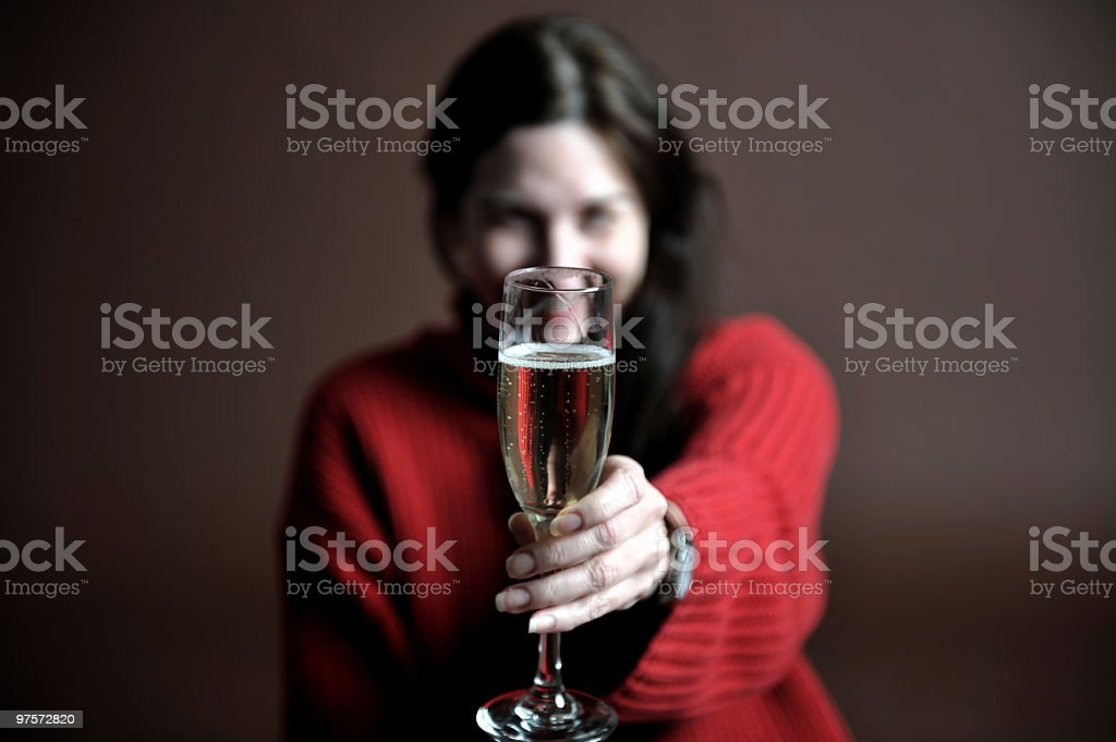 Woman holding champagne royalty-free stock photo