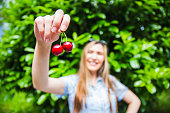 Woman Holding cherry fruit