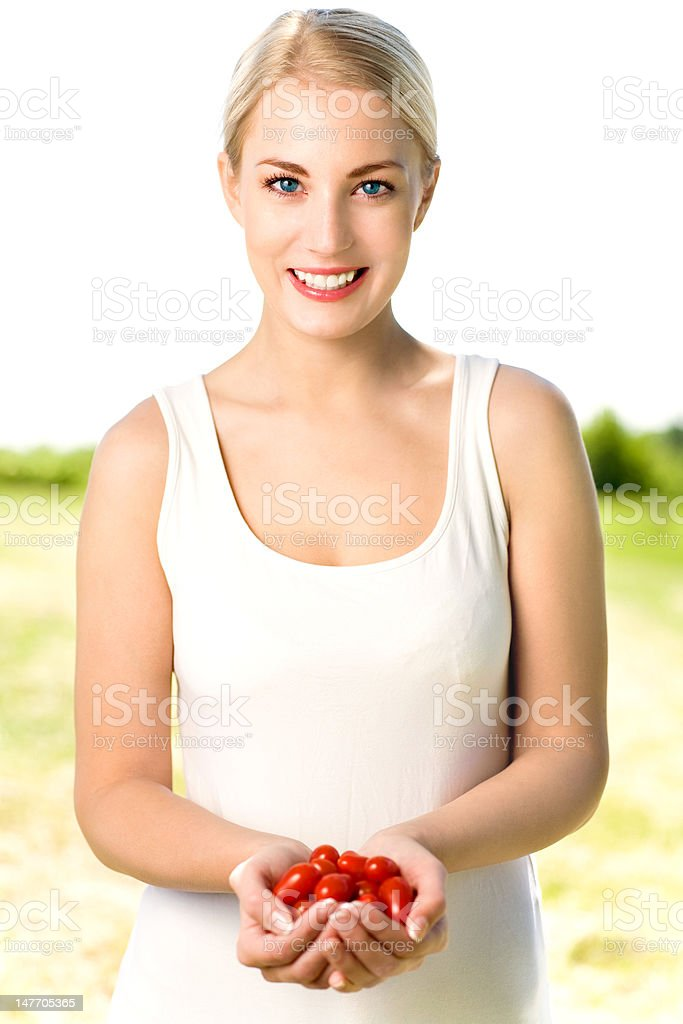 Woman holding cherry tomatoes royalty-free stock photo