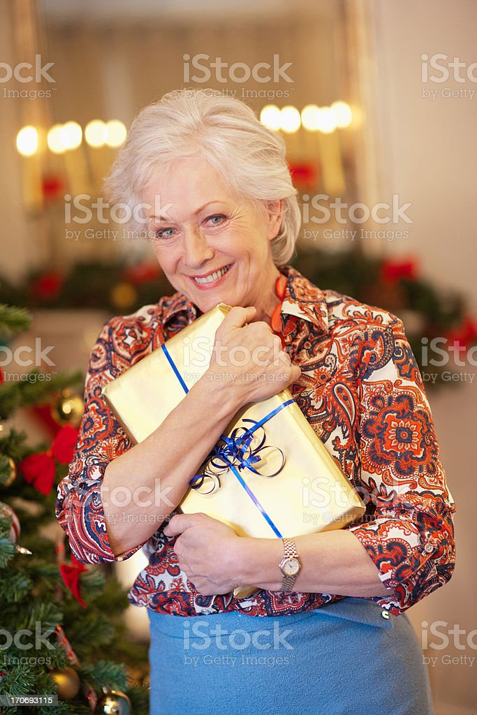 Woman holding Christmas gift royalty-free stock photo