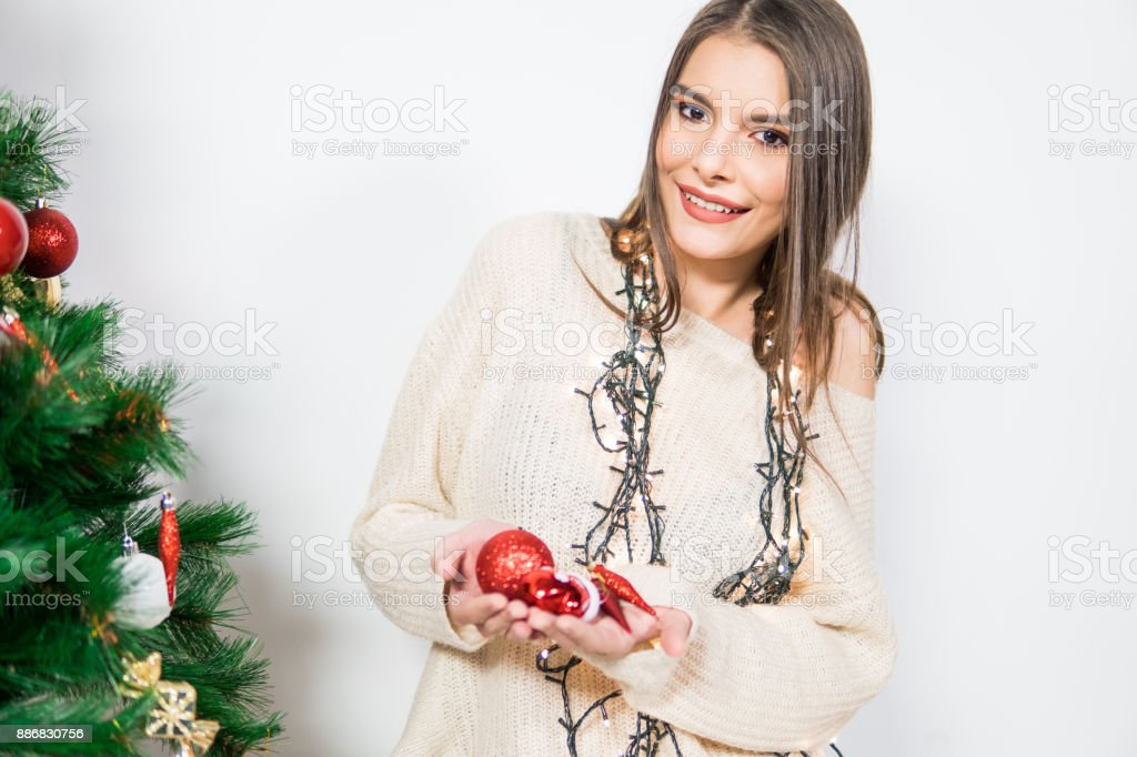 Woman holding Christmas ornaments in hands stock photo