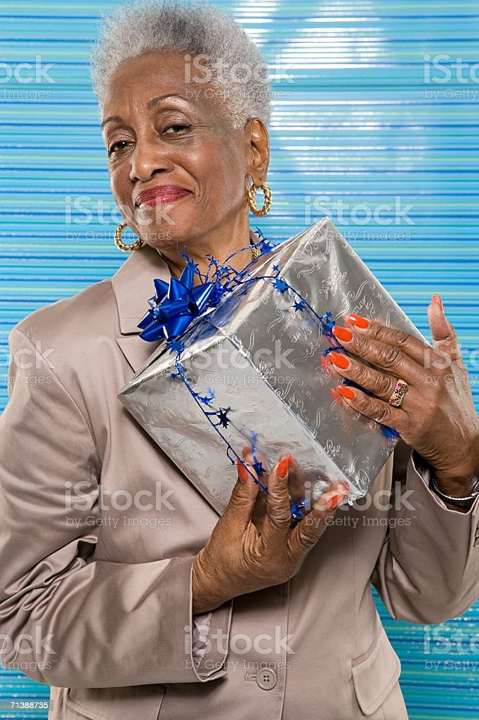 Woman holding Christmas present royalty-free stock photo