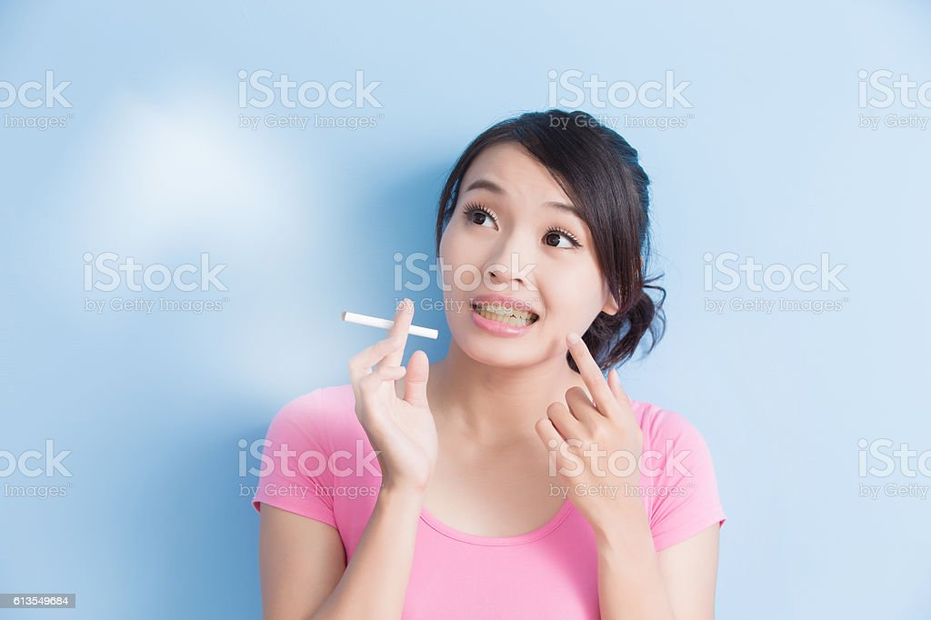 Woman holding cigarettes stock photo