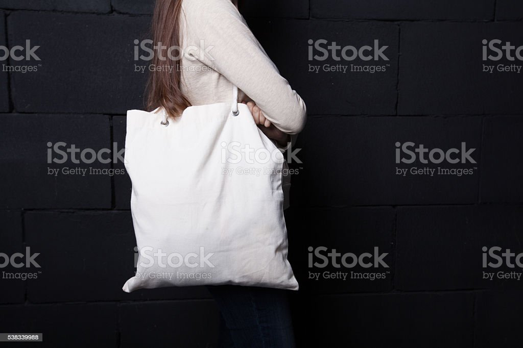 Woman holding clean shopping bag stock photo