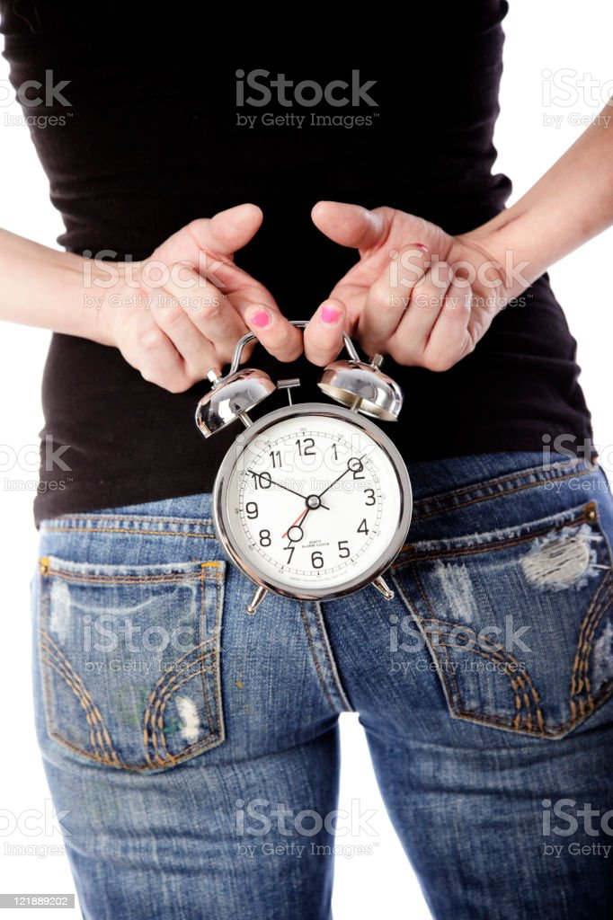 Woman Holding Clock Behind Back royalty-free stock photo