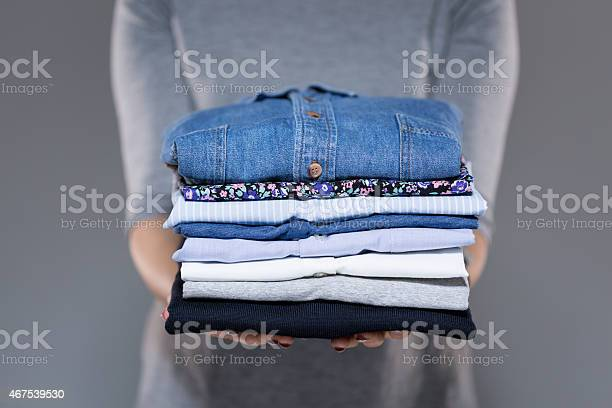 Woman holding clothes in hands picture id467539530?b=1&k=6&m=467539530&s=612x612&h=ya0yikilctknvjmtkqpg2p7wx0giqhm 1addijpo0ec=