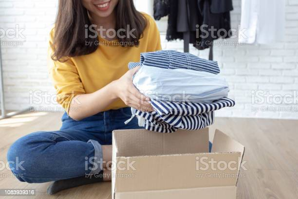 Woman holding clothes with donate box in her room donation concept picture id1083939316?b=1&k=6&m=1083939316&s=612x612&h=0opeoupbctgpuo54v9ks3jvgbuoinsvce47aaizfhpk=