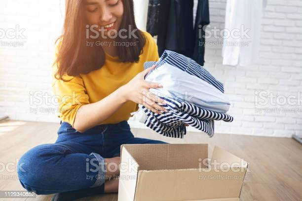 Woman holding clothes with donate box in her room donation concept picture id1129340852?b=1&k=6&m=1129340852&s=612x612&h=hkwpoiv3oel0tkrbjlpbxgvmsuut9echu5fewbfs53c=