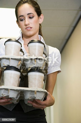 1161501551 istock photo Woman holding coffee cups 535025091