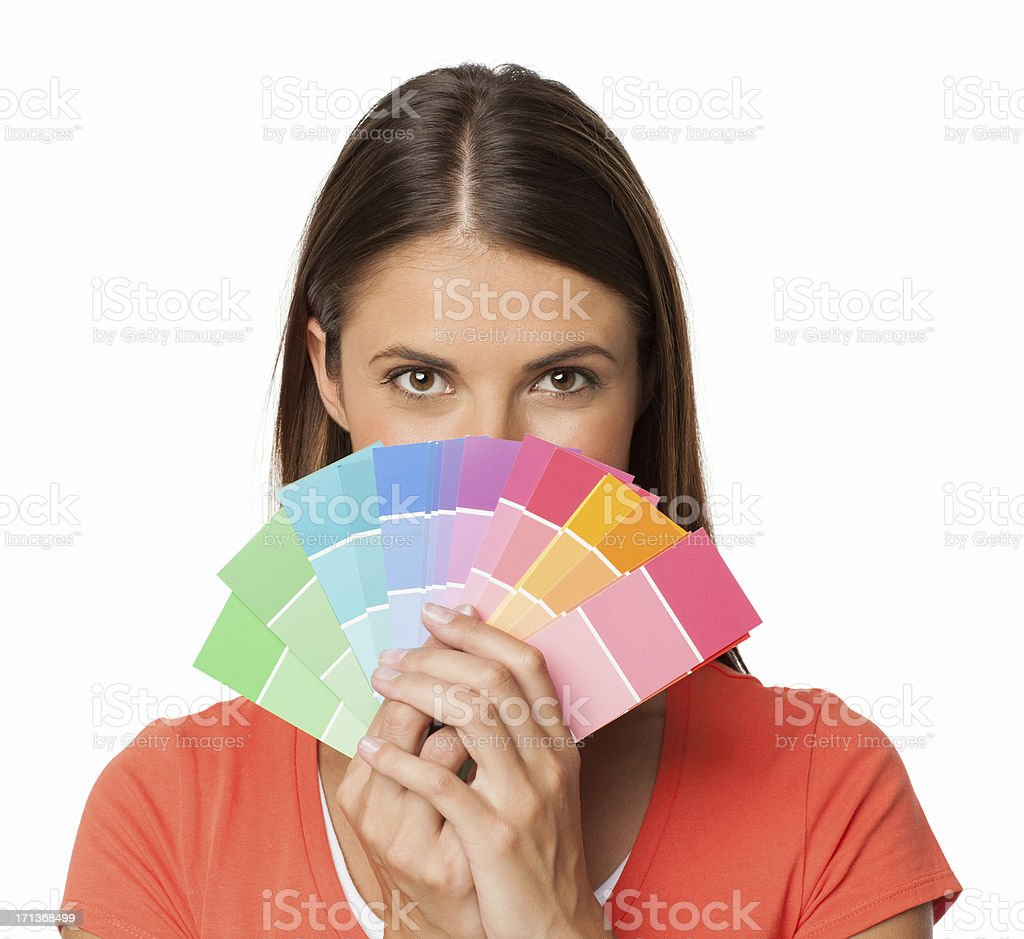 Woman Holding Color Swatches Over Her Face - Isolated stock photo