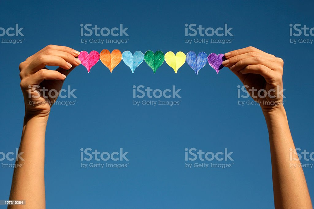 woman holding colorful hearts royalty-free stock photo