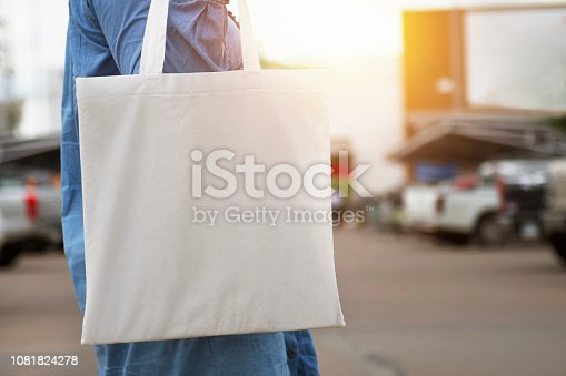 istock woman holding cotton bag for shopping. eco concept 1081824278