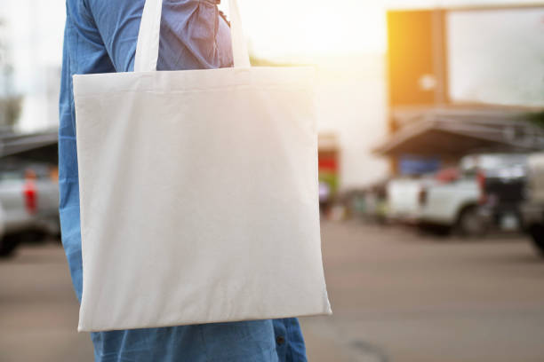 woman holding cotton bag for shopping. eco concept woman holding cotton bag for shopping. eco concept bag stock pictures, royalty-free photos & images