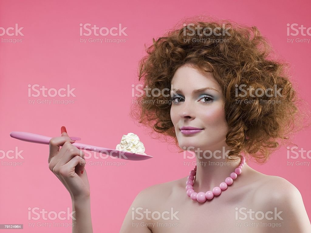 Woman holding cream on a spoon royalty-free 스톡 사진