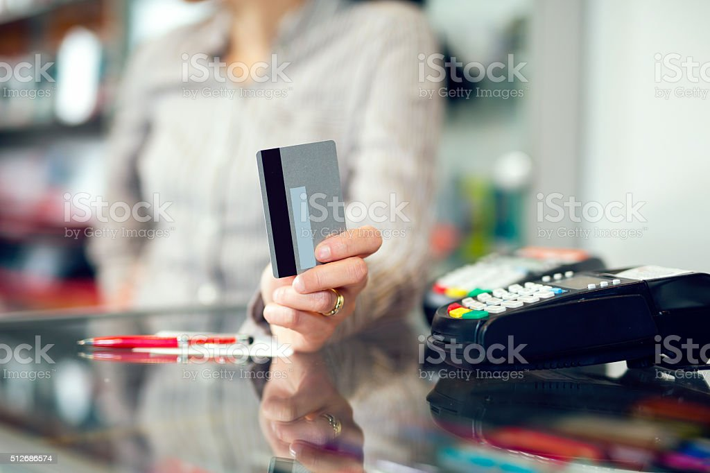 Woman holding credit card in hand stock photo