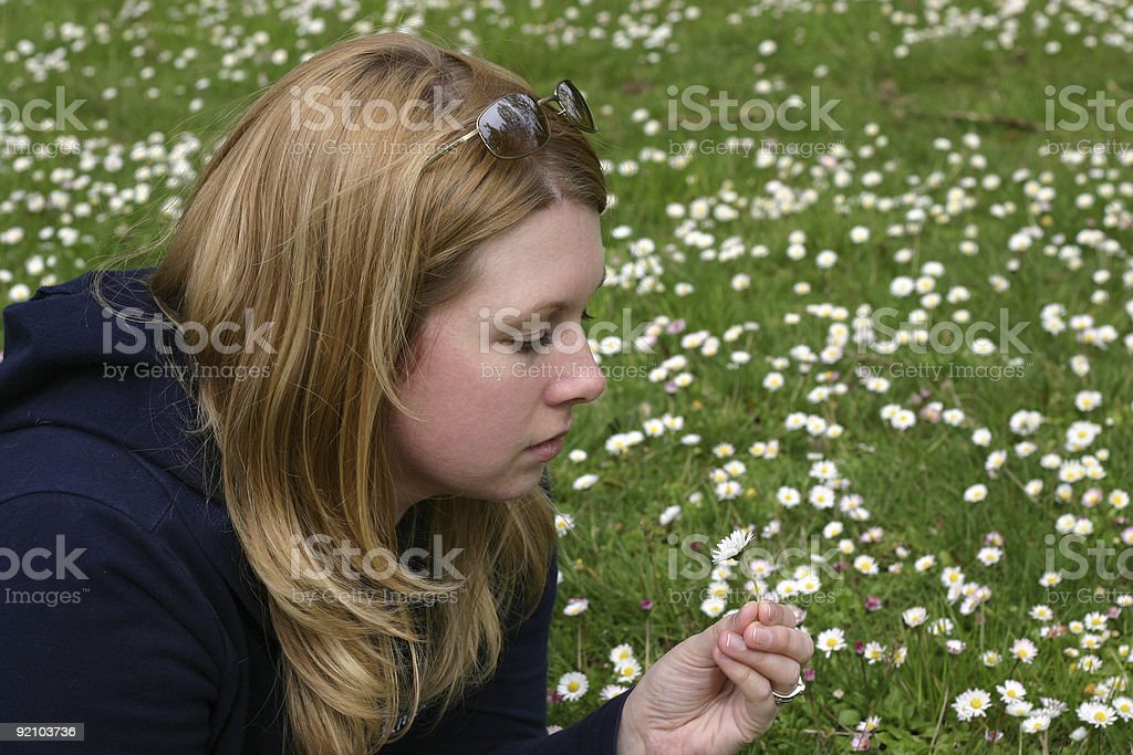 Woman holding daisy stock photo