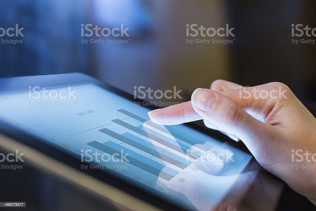 Woman holding digital tablet, closeup stock photo