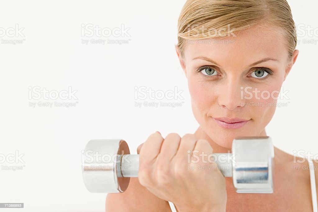 Woman holding dumbbell royalty-free stock photo