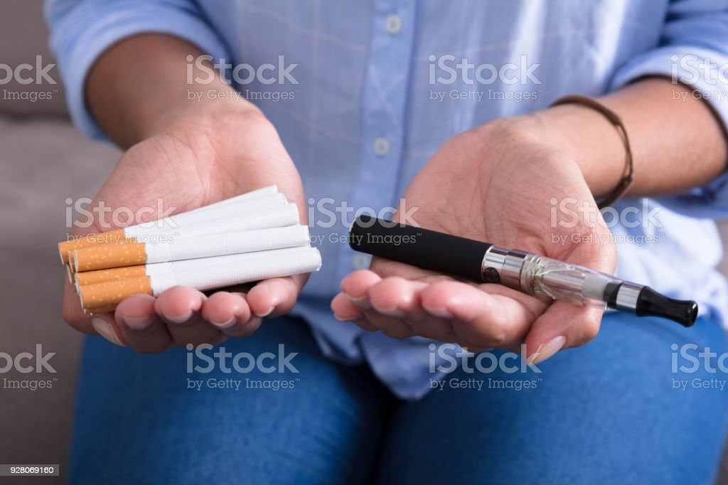 Woman Holding Electronic Cigarette stock photo
