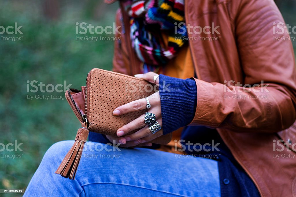 Woman holding empty wallet. Poverty, taxes, debts and other problems. stock photo