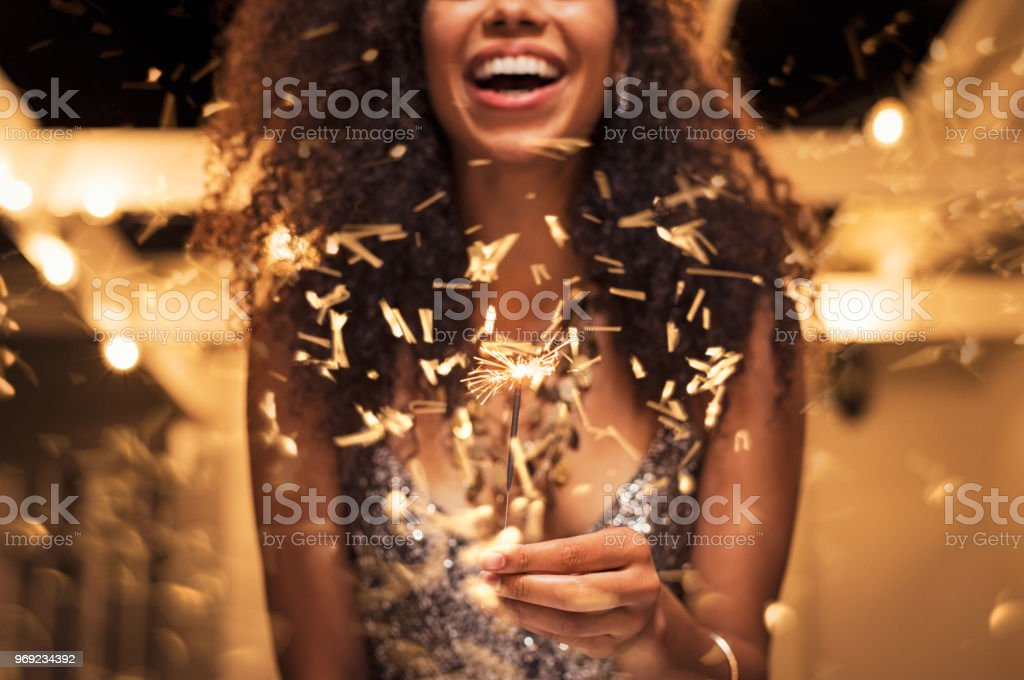 Woman holding fire sparkler stock photo