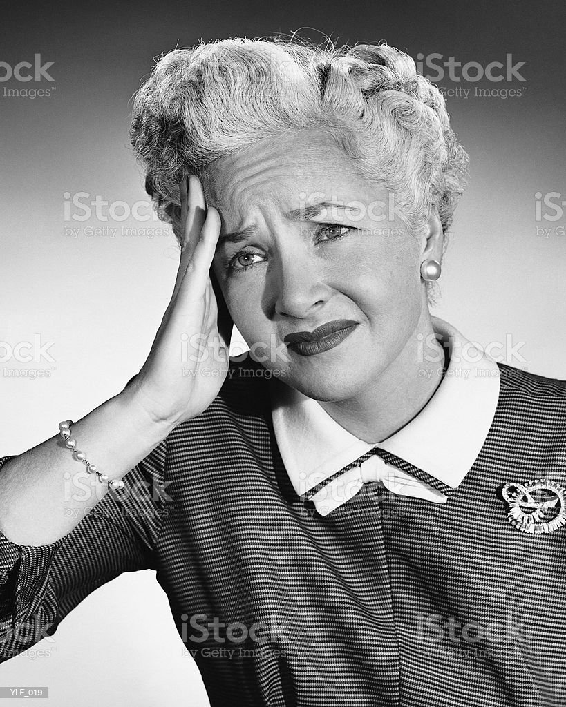 Woman holding forehead royalty free stockfoto