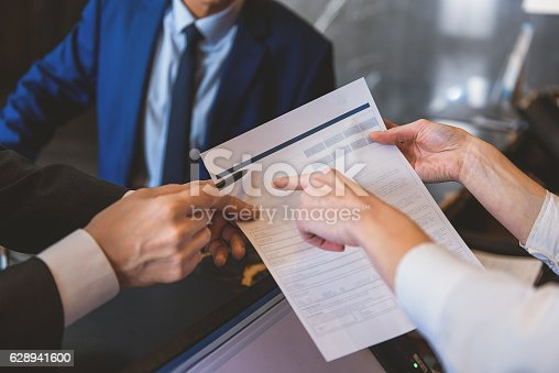 istock Woman holding form to fill in 628941600