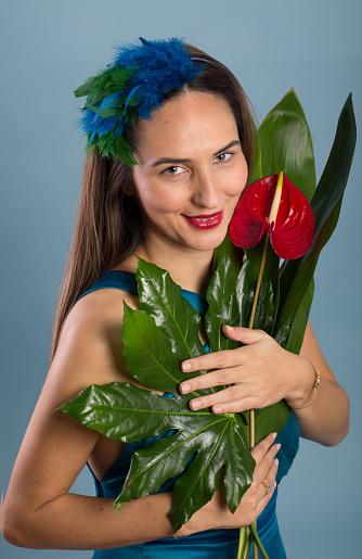 Woman holding fresh anthurium flower