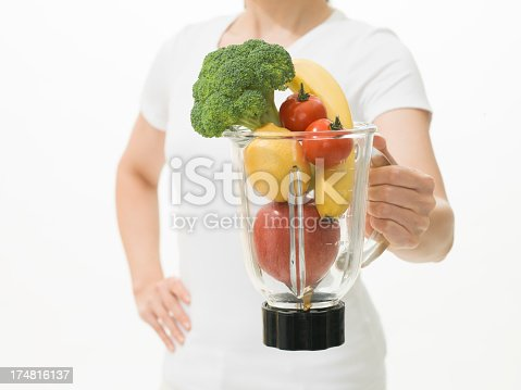 Woman holding fruit and Vegetable juicer