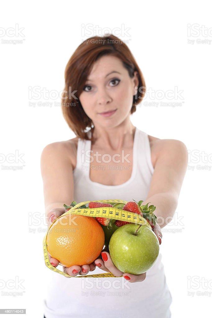 woman holding fruit bond measure tape slave to diet stock photo