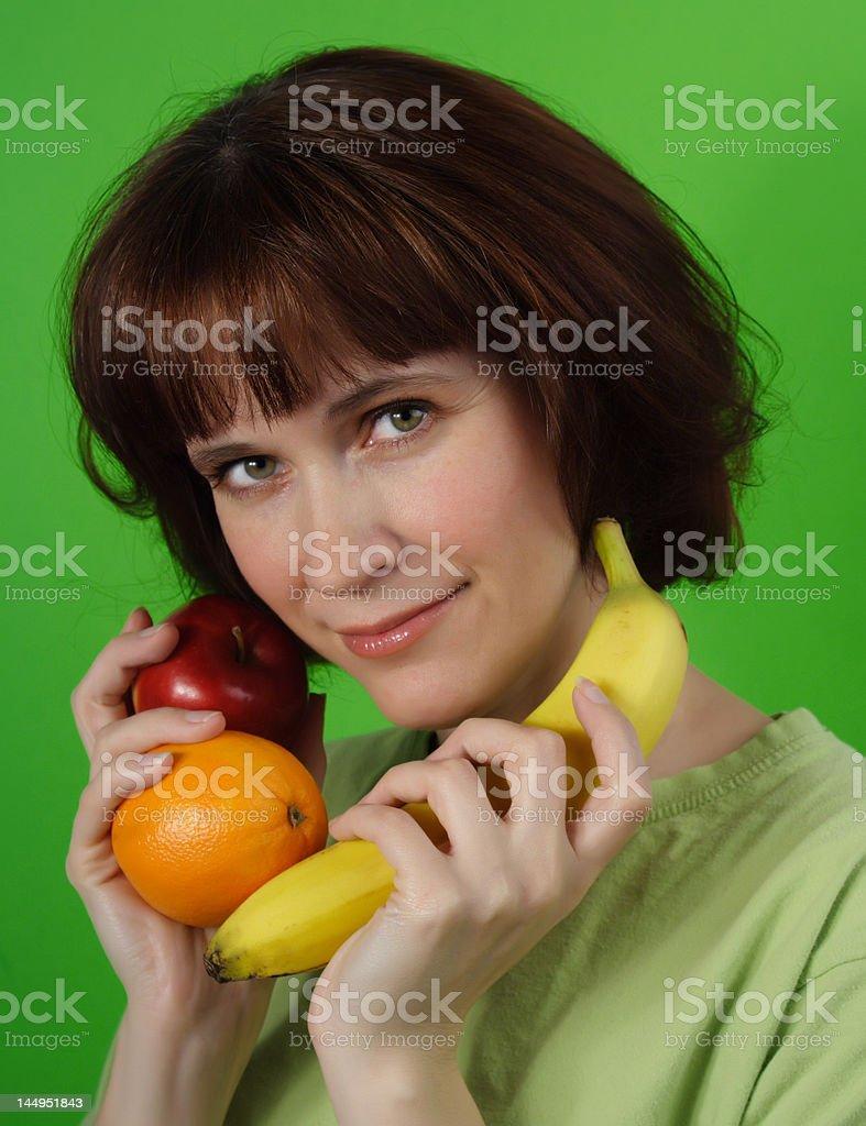 woman holding fruits stock photo
