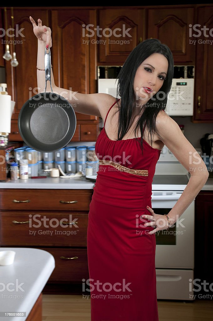 Woman Holding Frying Pan royalty-free stock photo