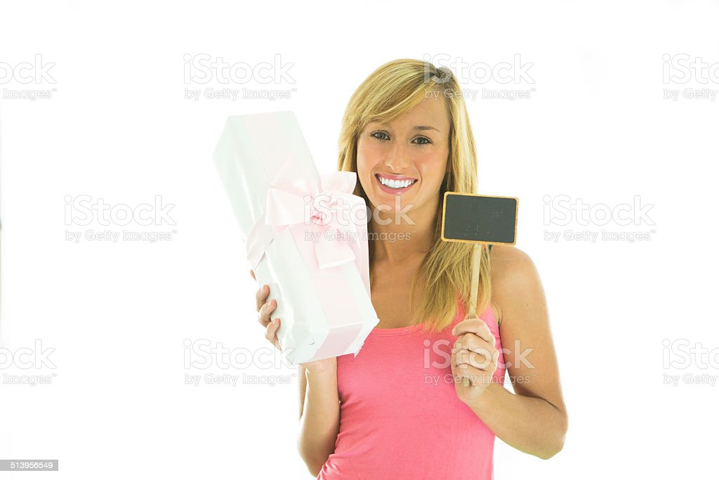 Woman holding gift and blackboard stock photo