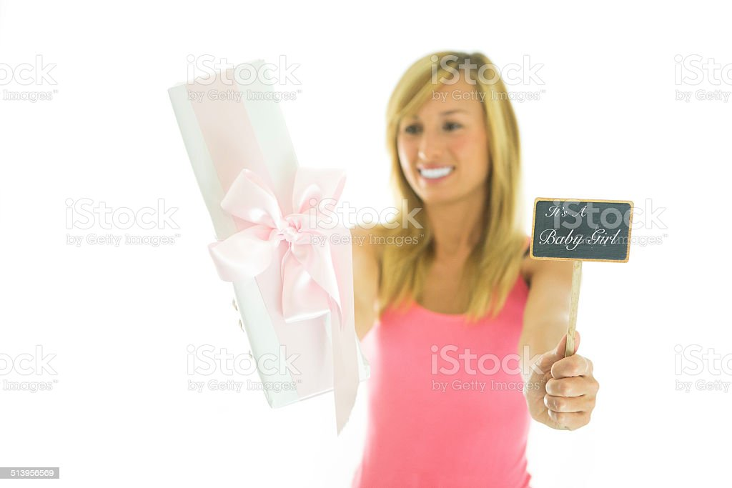 Woman holding gift and blackboard written It's a girl stock photo