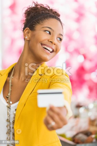 istock Woman holding gift card 513602193