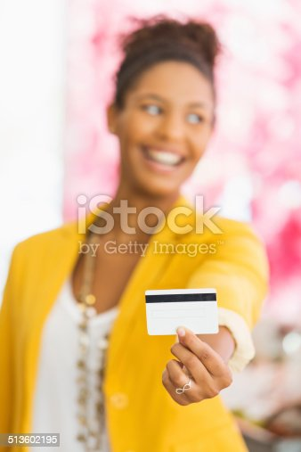 istock Woman holding gift card 513602195
