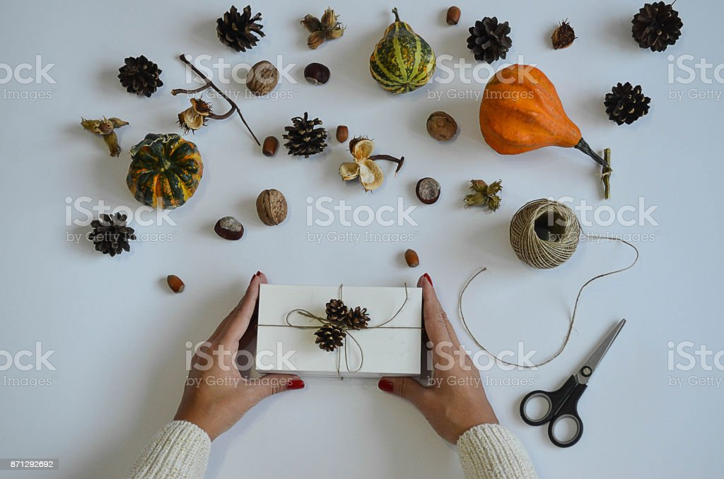 Woman holding gift, laid out against a background stock photo