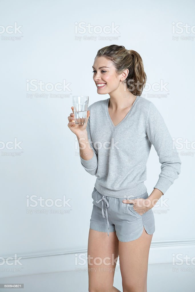 Woman Holding Glass Of Water In House royalty-free stock photo