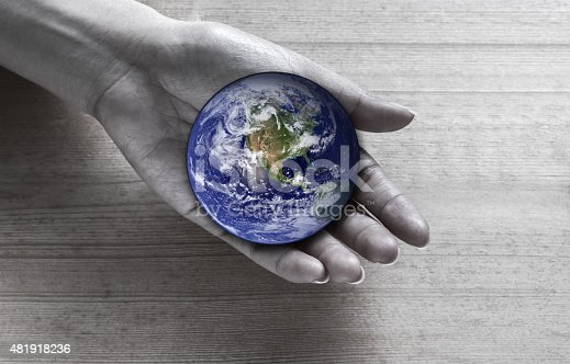 istock Woman holding global in hand , Elements of this image furnished 481918236