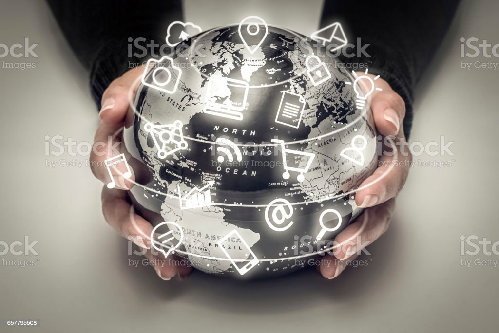 woman holding globe and media icons flying around stock photo