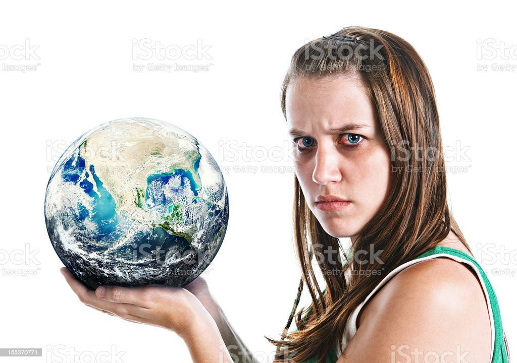 Woman holding globe looks angry: perhaps at state of world royalty-free stock photo