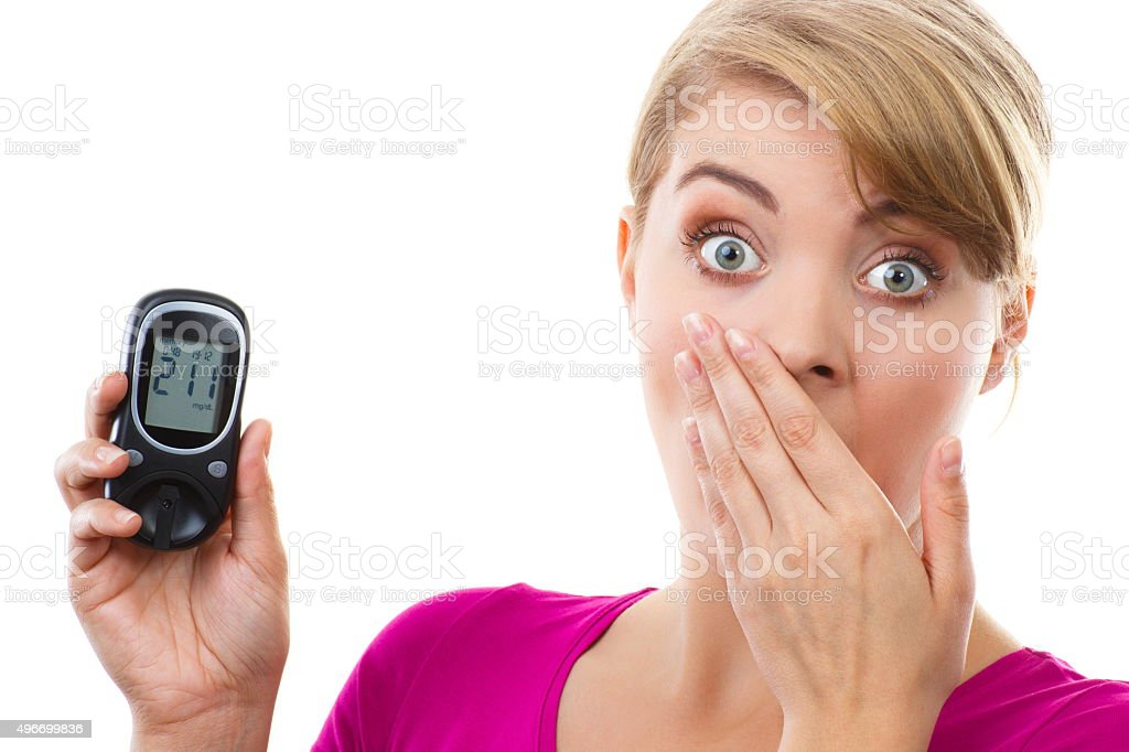 Woman holding glucometer, checking sugar level, concept of diabetes stock photo