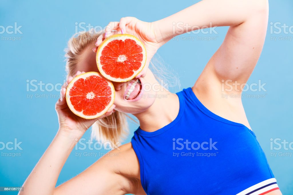 Woman holding grapefruit citrus fruit in hands royalty-free stock photo