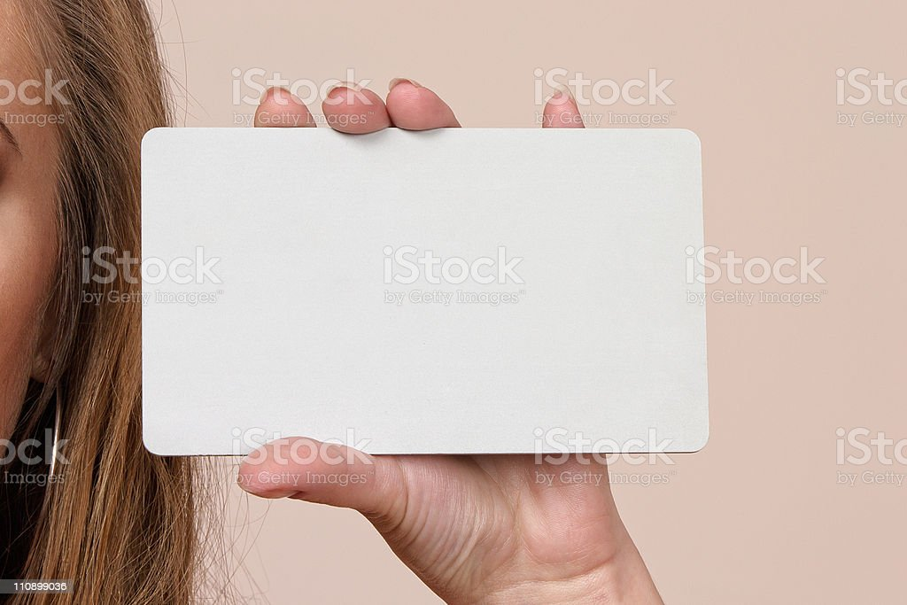 Woman holding gray businesscard royalty-free stock photo