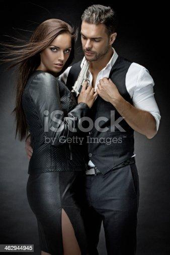 istock woman holding gun to man's neck 462944945